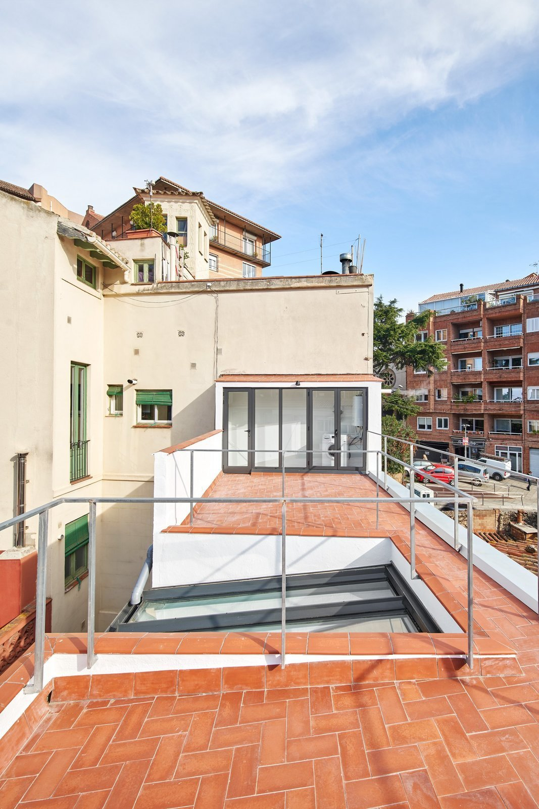 Outdoor and Rooftop  Photo 16 of 17 in Picture Windows and Sliding Doors Work Magic in This Cozy Barcelona Home