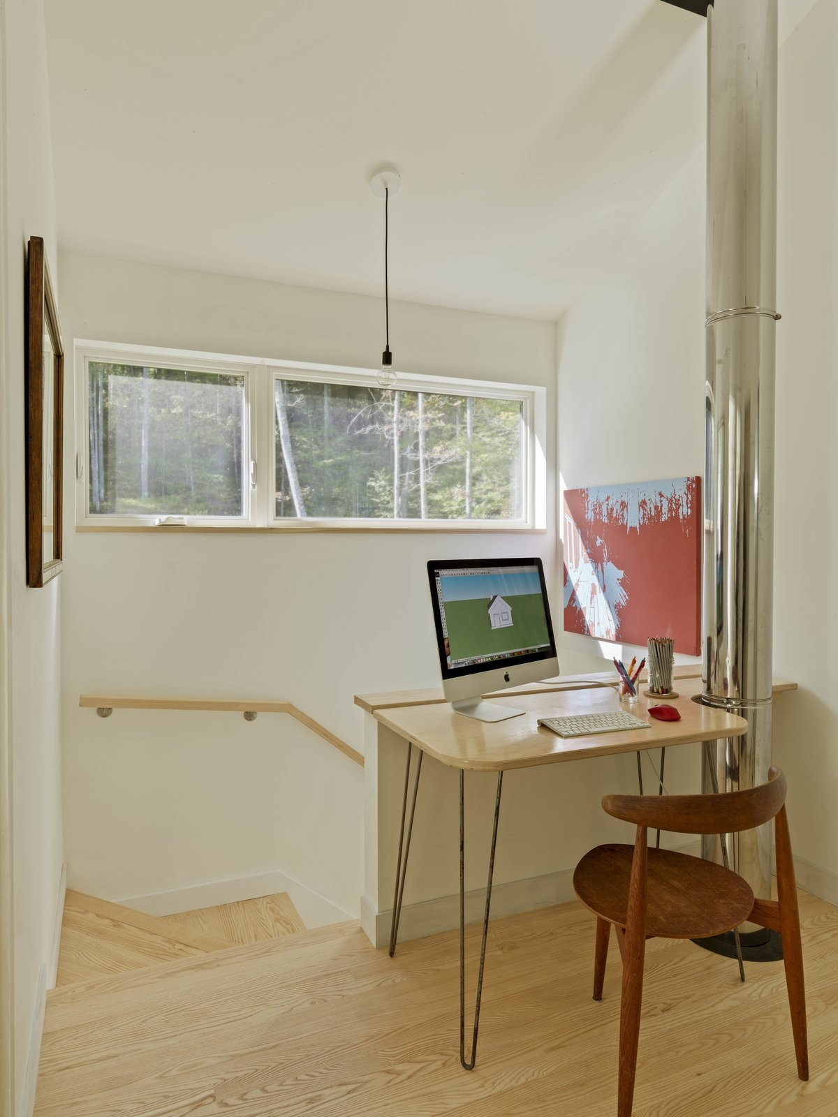 Office, Chair, Light Hardwood Floor, Study Room Type, Desk, and Lamps  Photo 3 of 13 in A Little Black Cabin Keeps Things Simple for a Family of Four in Vermont