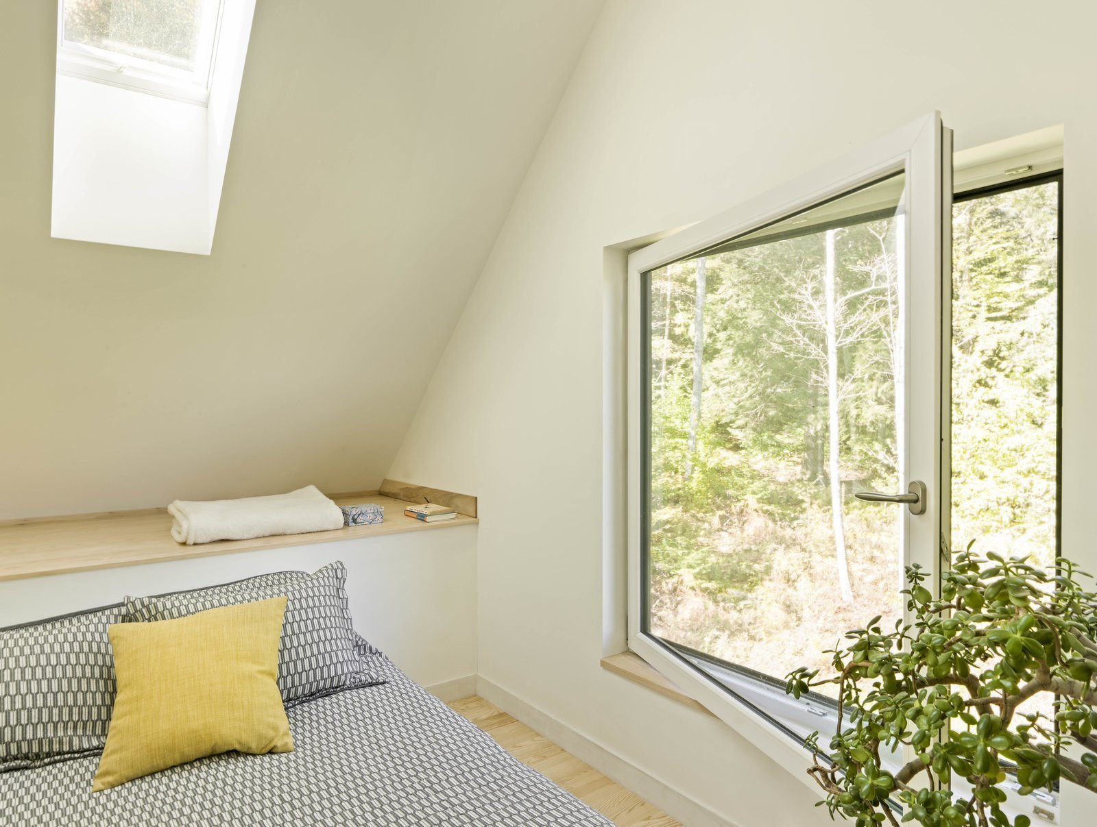 Bedroom, Bed, Shelves, and Light Hardwood Floor  Photo 9 of 13 in A Little Black Cabin Keeps Things Simple for a Family of Four in Vermont