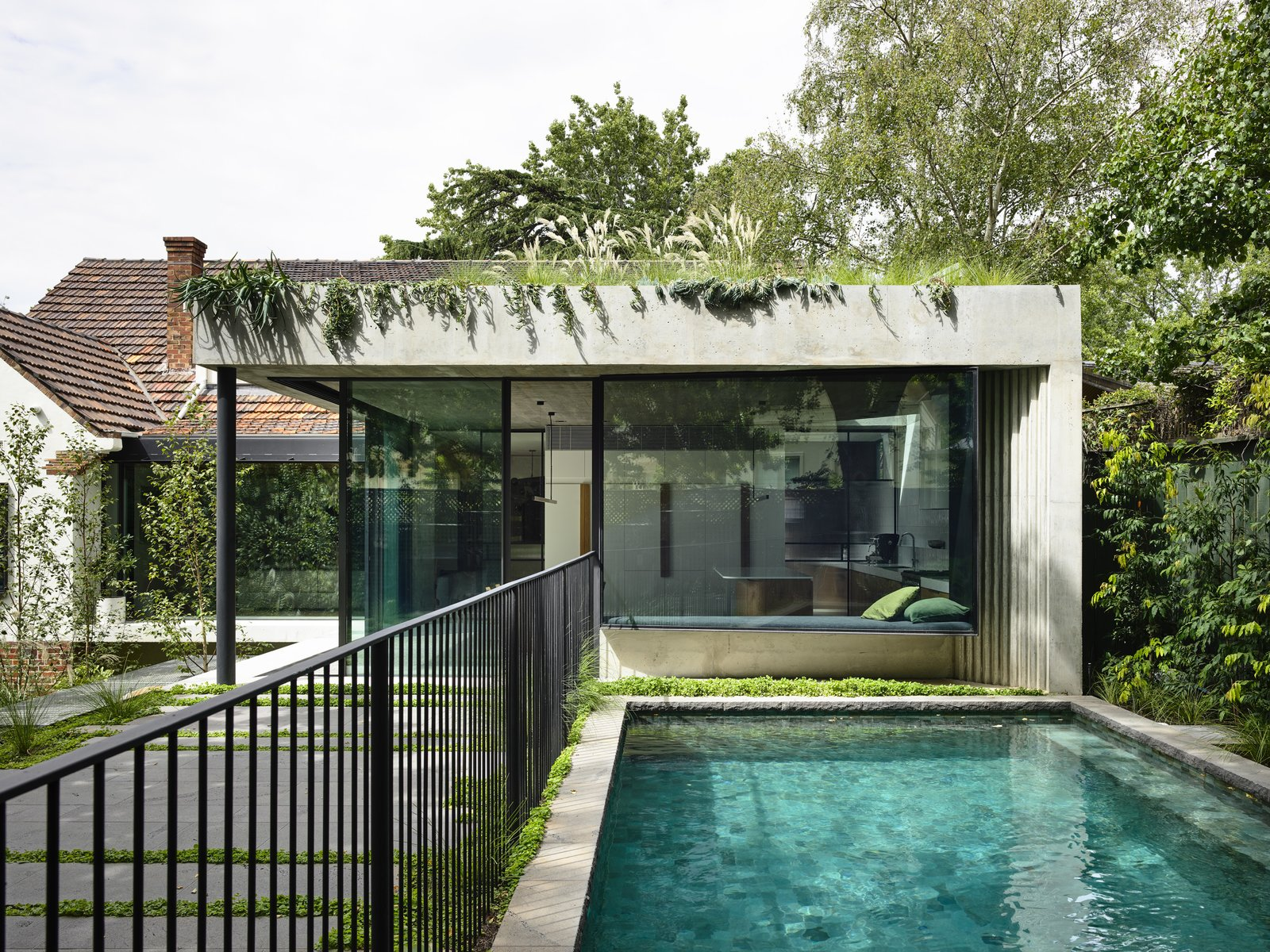 Photo 1 of 18 in A Concrete and Glass Pavilion Opens This 1930s Home to a Tiered Garden