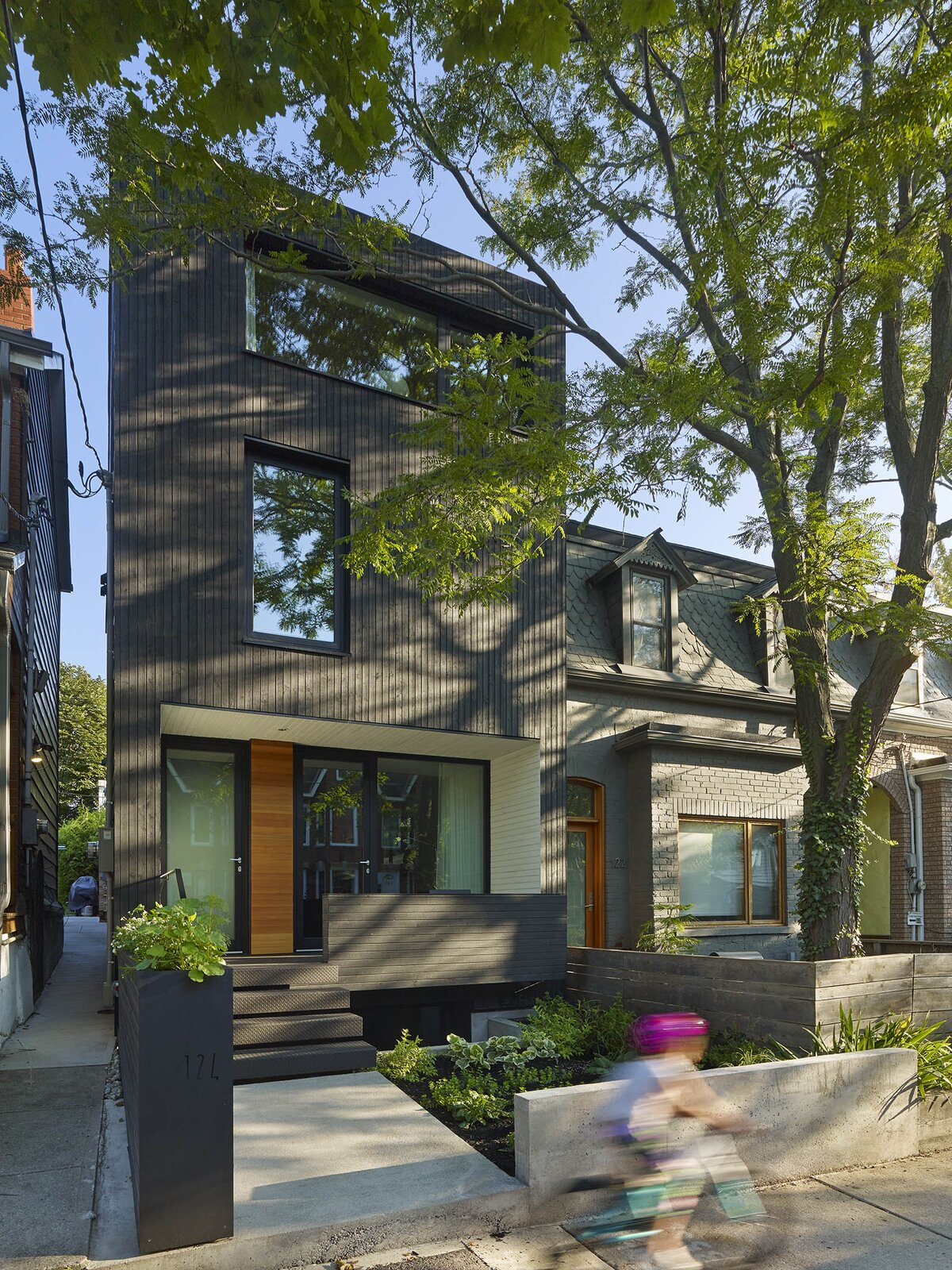 Exterior, House Building Type, and Wood Siding Material  Photo 1 of 16 in An Architect Couple Turn an Urban Eyesore Into a Home That's Both Peaceful and Playful from Bellwoods Lodge
