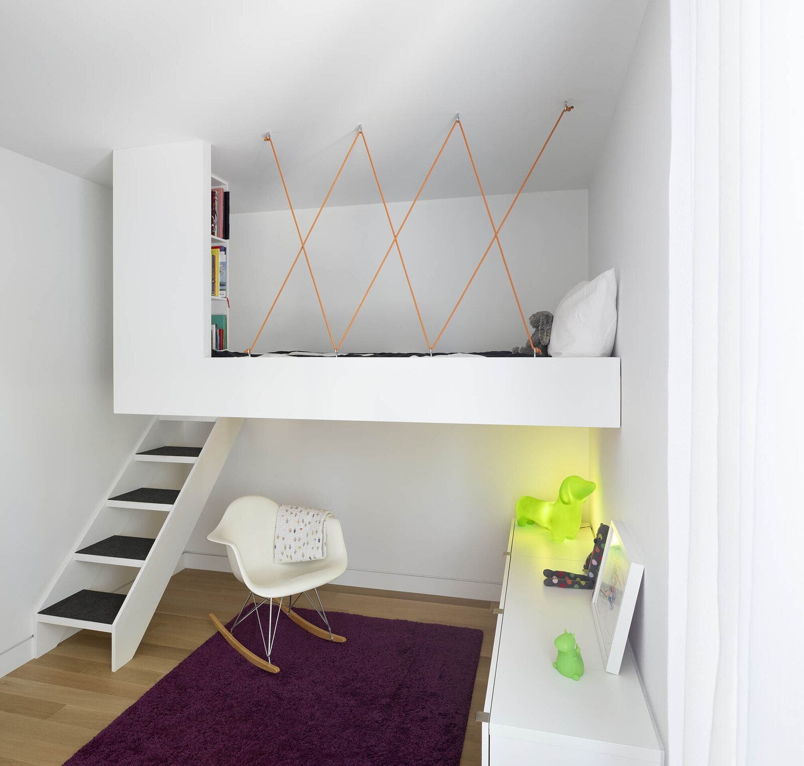 Bedroom, Bunks, Rug Floor, Chair, Shelves, Light Hardwood Floor, Bed, and Rockers  Photo 12 of 16 in An Architect Couple Turn an Urban Eyesore Into a Home That's Both Peaceful and Playful from Bellwoods Lodge