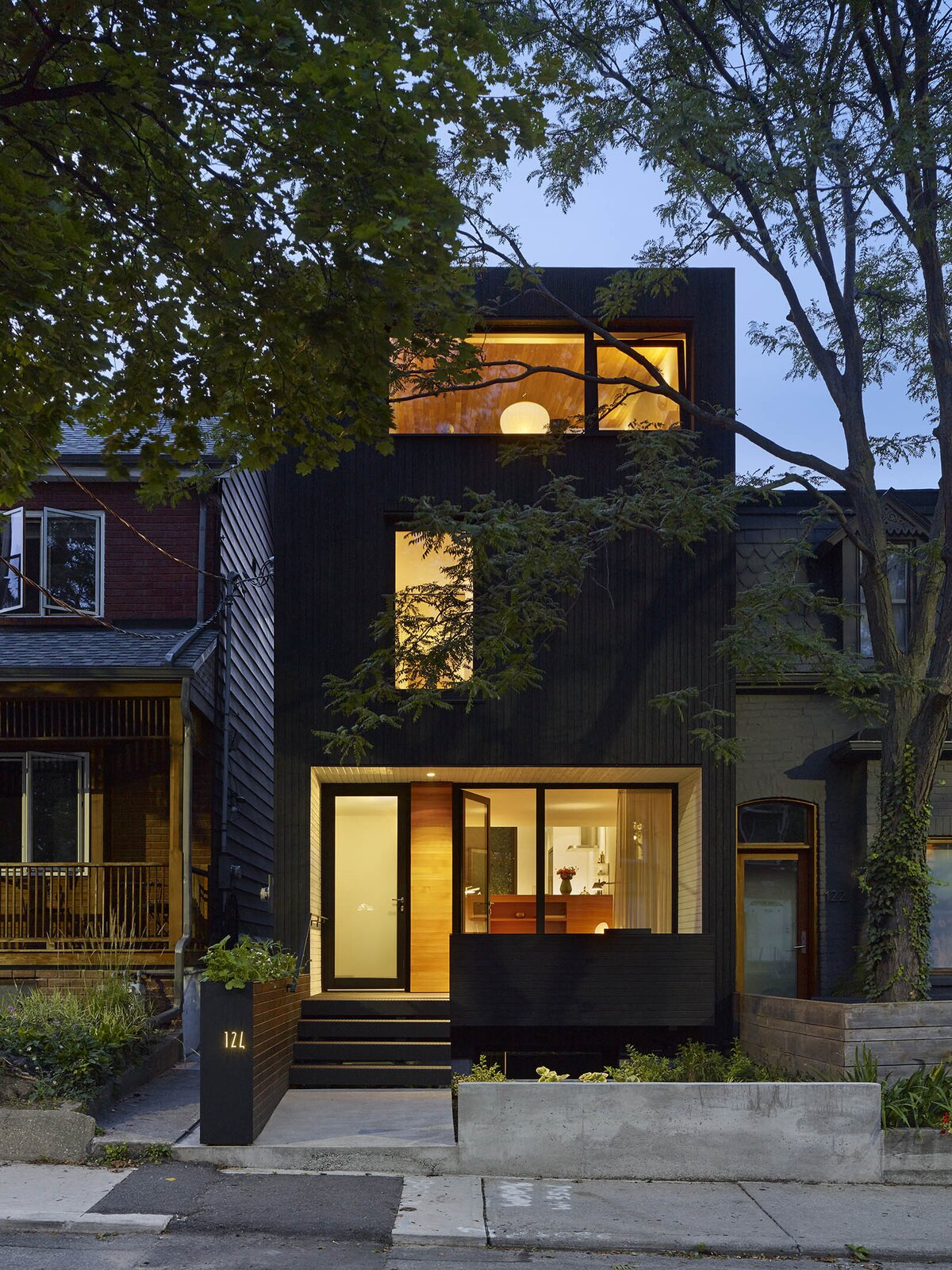 Exterior, House Building Type, and Wood Siding Material  Photo 16 of 16 in An Architect Couple Turn an Urban Eyesore Into a Home That's Both Peaceful and Playful from Bellwoods Lodge