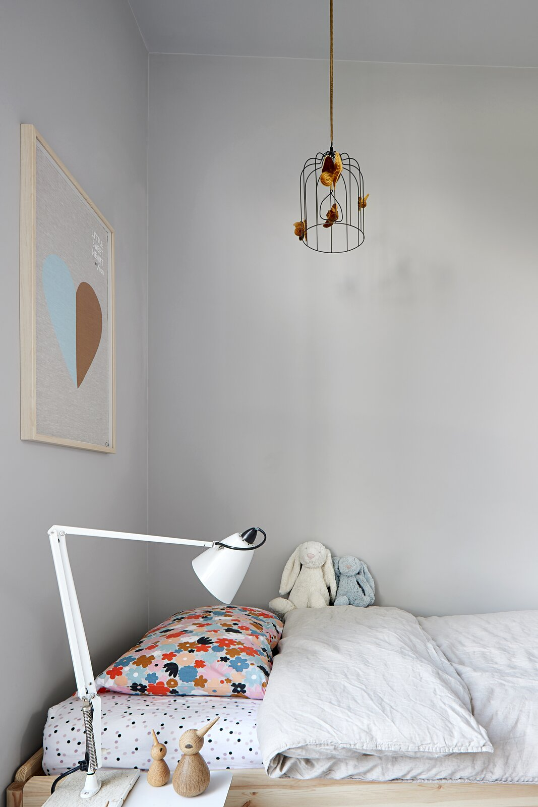 Kids Room, Girl Gender, Lamps, Toddler Age, Neutral Gender, Bed, and Bedroom Room Type  Photo 17 of 20 in A Concrete House Is Softened by an Airy Internal Courtyard, Complete With an Olive Grove from Ruxton Rise Residence