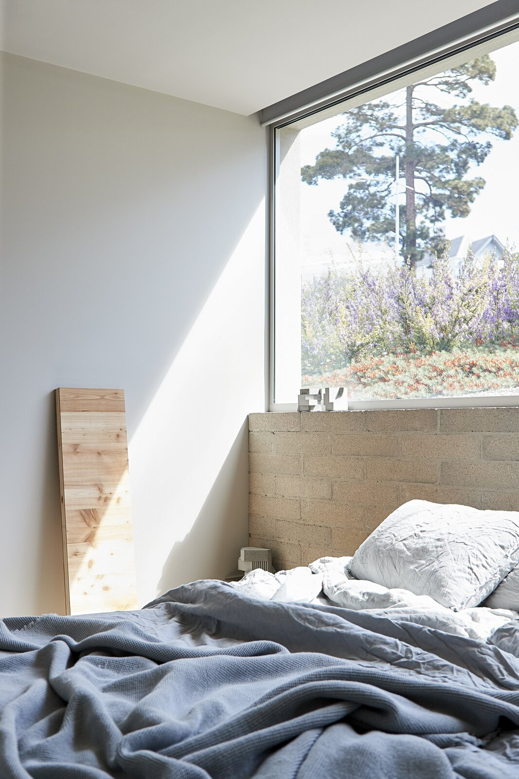 Bedroom and Bed  Photo 19 of 20 in A Concrete House Is Softened by an Airy Internal Courtyard, Complete With an Olive Grove from Ruxton Rise Residence