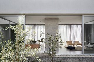 A Concrete House Is Softened by an Airy Internal Courtyard, Complete With an Olive Grove