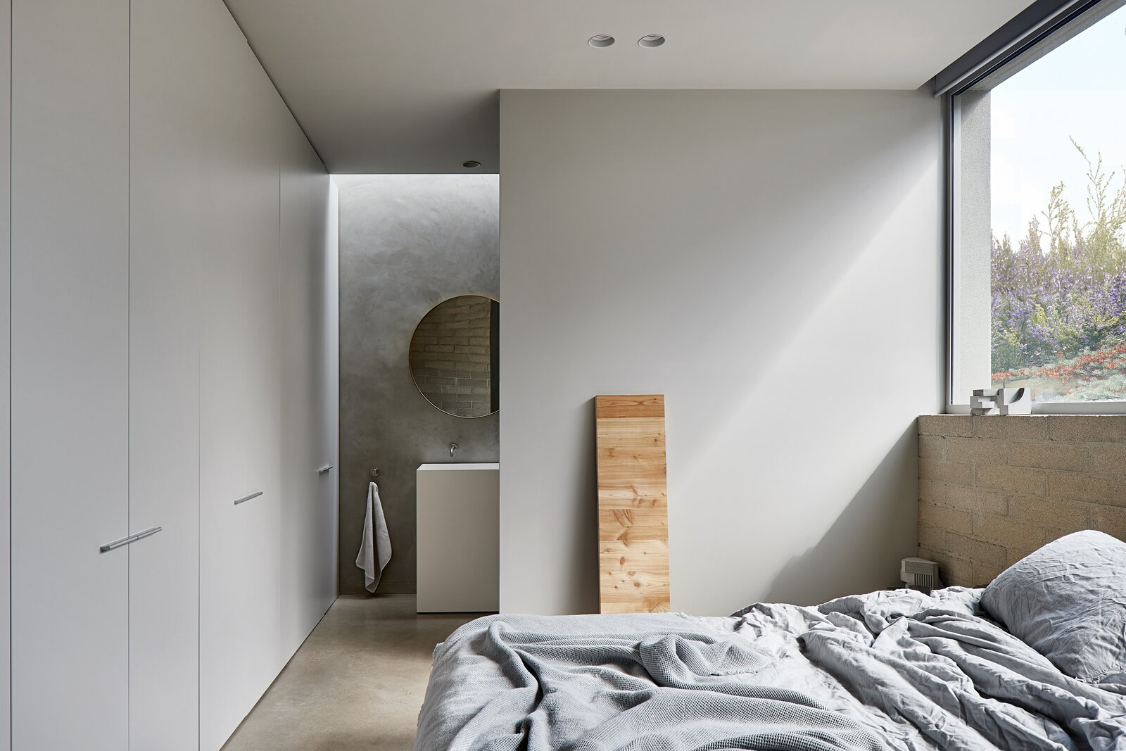 Bedroom, Bed, Storage, Concrete Floor, Recessed Lighting, and Ceiling Lighting  Ruxton Rise Residence