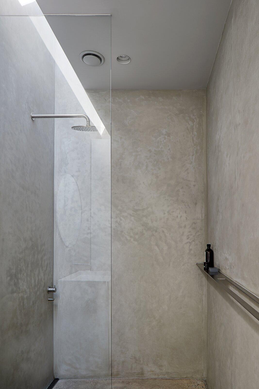 Bath Room, Concrete Floor, Recessed Lighting, Ceiling Lighting, and Corner Shower  Ruxton Rise Residence