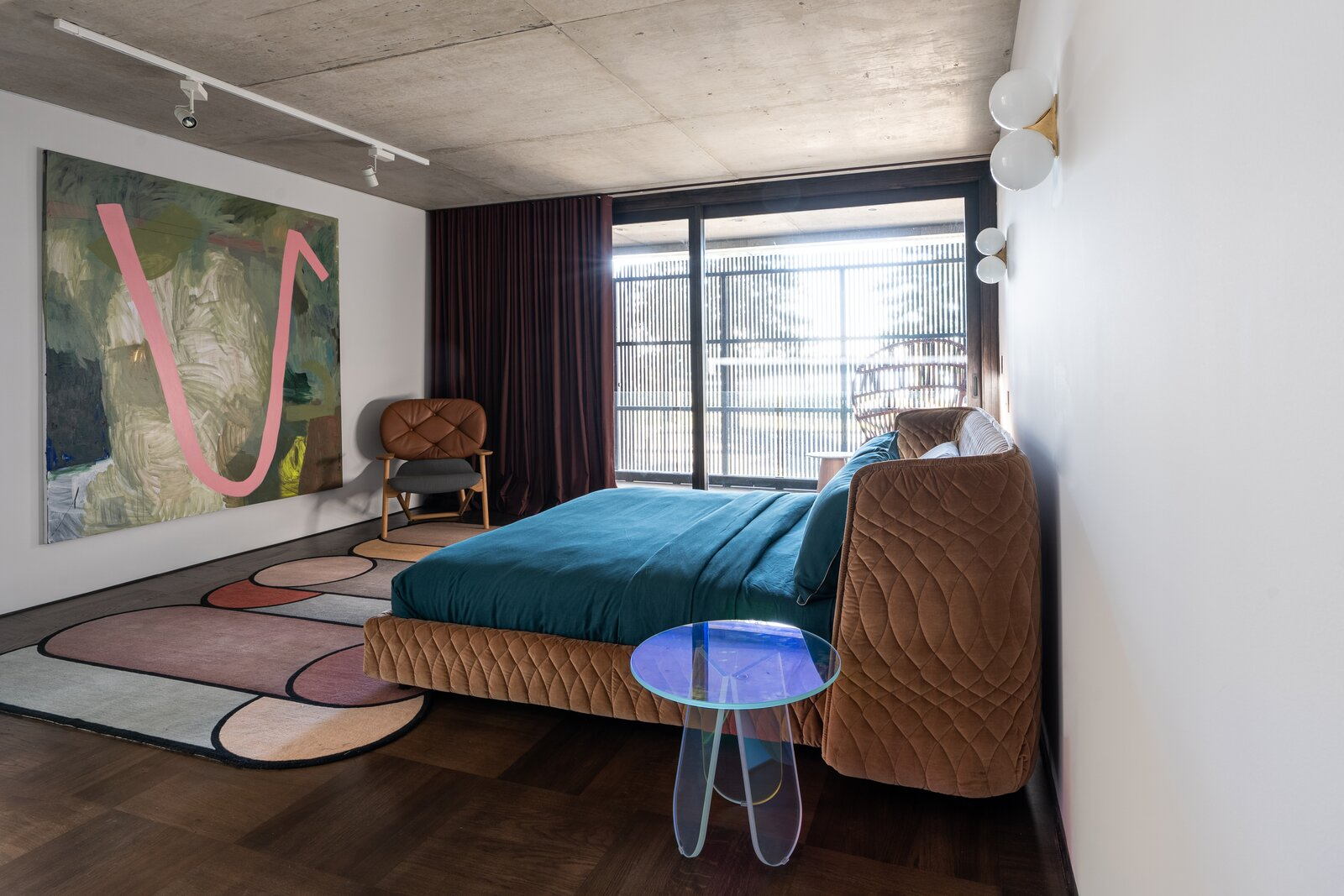 Bedroom, Track Lighting, Bed, Dark Hardwood Floor, Wall Lighting, Medium Hardwood Floor, and Rug Floor  Photo 12 of 23 in Mechanized Shutters Protect This Australian Home From Prying Eyes
