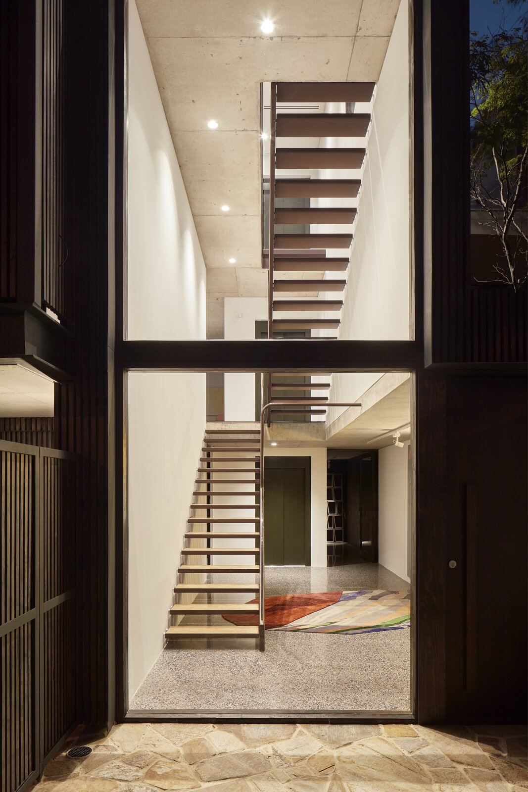 Staircase and Metal Railing  Photo 8 of 23 in Mechanized Shutters Protect This Australian Home From Prying Eyes from Shutter House