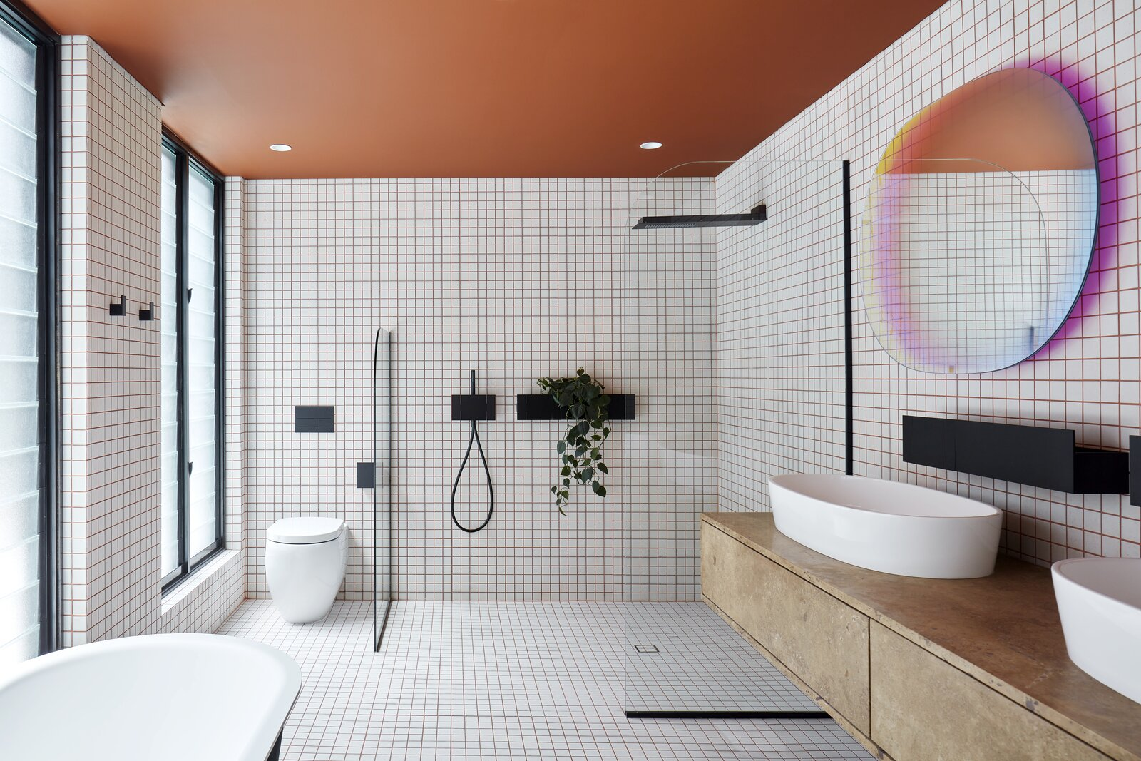 Bath Room, Stone Counter, One Piece Toilet, Ceramic Tile Floor, Open Shower, Vessel Sink, Recessed Lighting, Subway Tile Wall, Freestanding Tub, and Ceramic Tile Wall  Photo 19 of 23 in Mechanized Shutters Protect This Australian Home From Prying Eyes from Shutter House