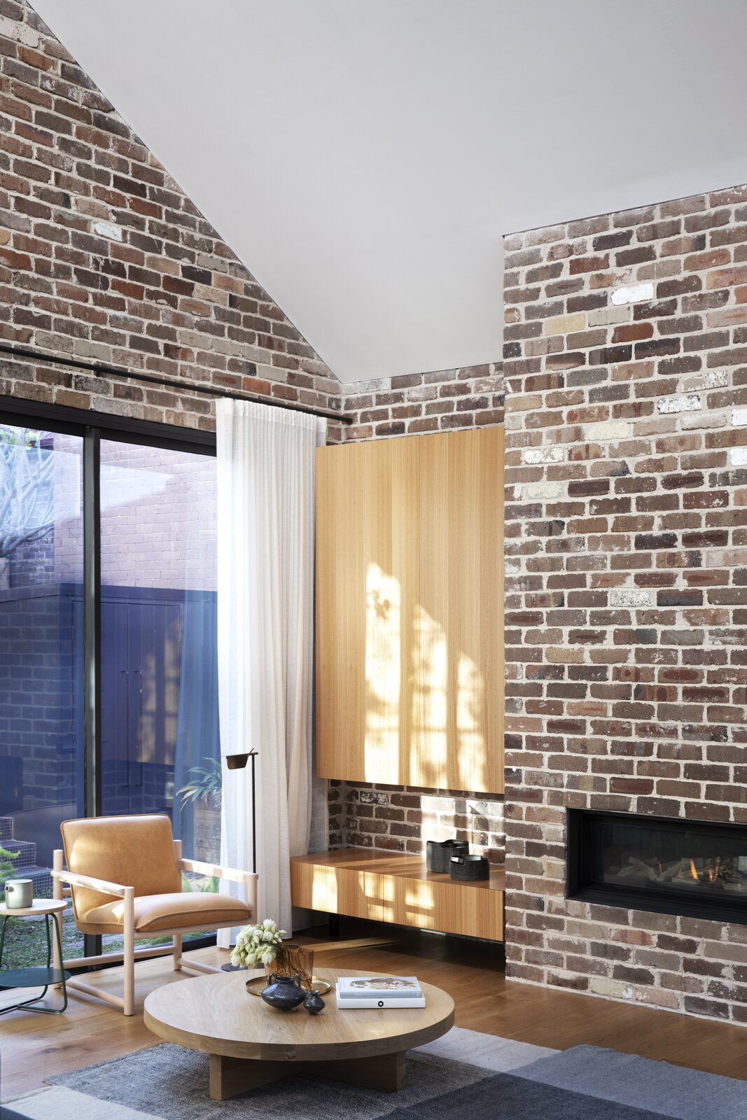 Cnr Virginia by Studio Prineas exposed brick wall and wood built-in cabinets