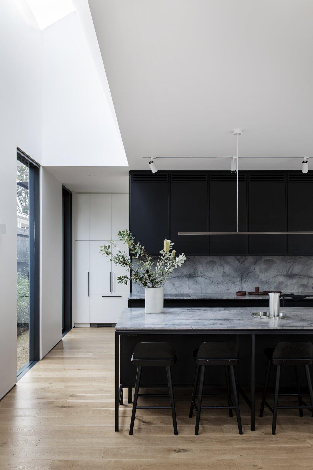 Cnr Virginia by Studio Prineas black and marble kitchen