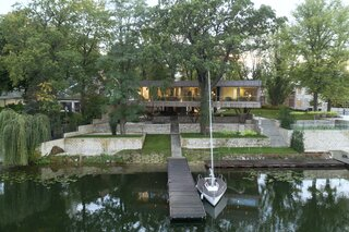 An Architect's Elevated Family Home Channels Mies van der Rohe on a German Lakefront