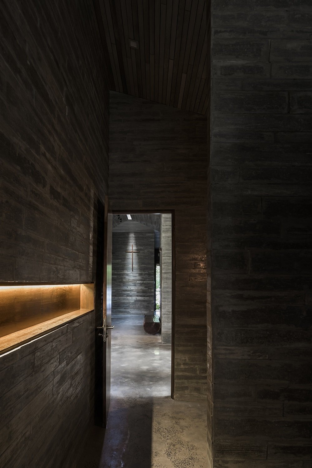Hallway, Dark Hardwood Floor, and Concrete Floor  Photo 10 of 16 in A Koi-Filled Moat Surrounds This Vietnamese House from Am house