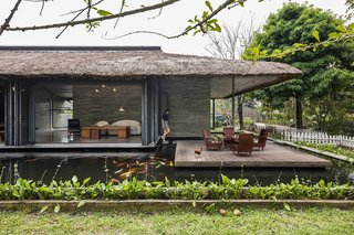 A Koi-Filled Moat Surrounds This Vietnamese House