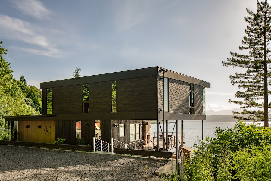 Exterior, Wood Siding Material, House Building Type, and Flat RoofLine  Photo 6 of 13 in A Waterfront Home in Washington Grows Two Hovering Wings