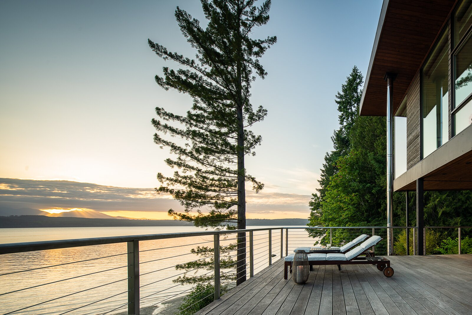 Outdoor, Trees, Wood Patio, Porch, Deck, Large Patio, Porch, Deck, and Shrubs  Photo 4 of 13 in A Waterfront Home in Washington Grows Two Hovering Wings
