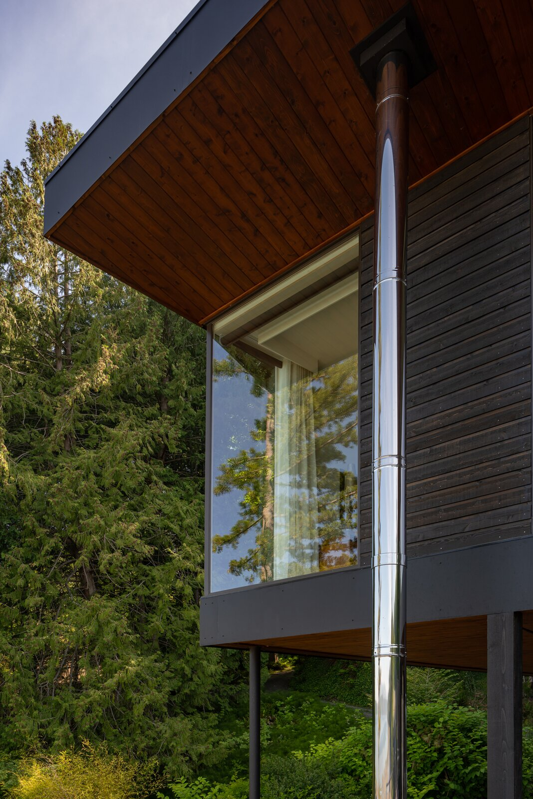 Exterior, Flat RoofLine, House Building Type, and Wood Siding Material  Photo 9 of 13 in A Waterfront Home in Washington Grows Two Hovering Wings