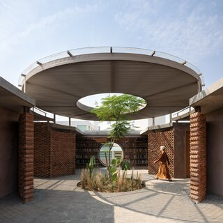 A Brick-and-Concrete Home With a Library Emphasizes Circular Motifs in Mexico