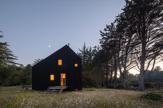An Angular Black Cabin in Coastal France Honors the Bucolic Landscape