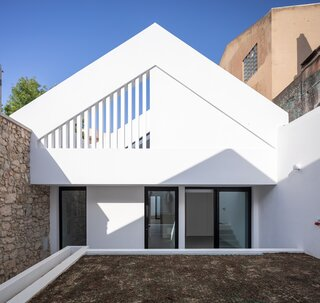 An 18th-Century Sawmill in Portugal Is Revived as a Striking White Gable Home